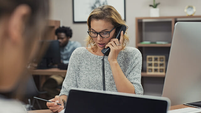 Woman on phone at desk